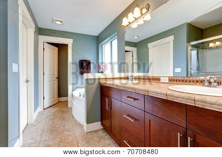 Bathrom Interior In Aqua Tone. Vanity Cabinet With Mirror