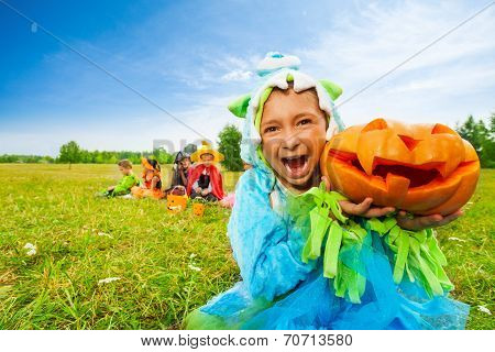 Scaring girl with open mouth in monster costume