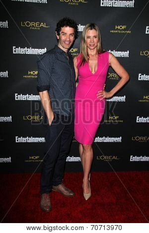 LOS ANGELES - AUG 23:  James Frain, Mira Sorvino at the 2014 Entertainment Weekly Pre-Emmy Party at Fig & Olive on August 23, 2014 in West Hollywood, CA