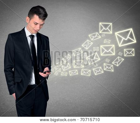 Business man with smartphone and email shape