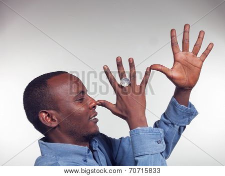 Young African boy with mocking gesture with two hands