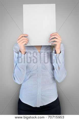 Business woman cover face with empty board