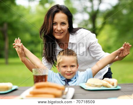 mother and son at picnic in park