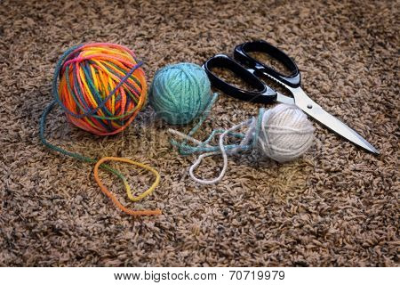Detail of balls of yarn and scissors for making crafts