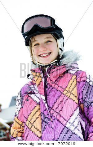 Happy Girl In Ski Helmet At Winter Resort