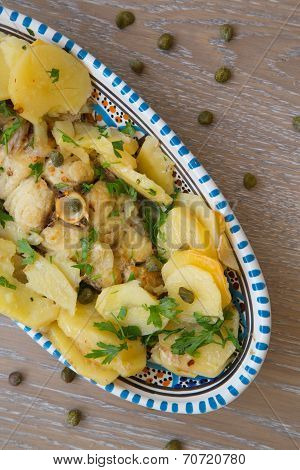 White Grouper With Potatoes And Capers Baked In The Stove