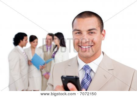 Portrait Of A Young Businessman Looking At His Cellphone