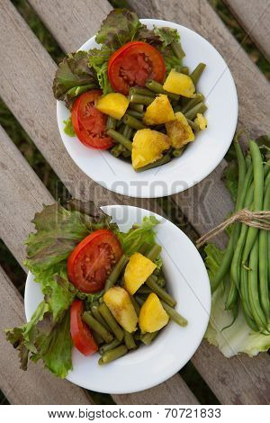 French String Bean Salad In White Dishes