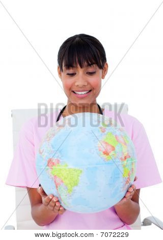Portrait Of A Beautiful Female Doctor Holding A Terrestrial Globe
