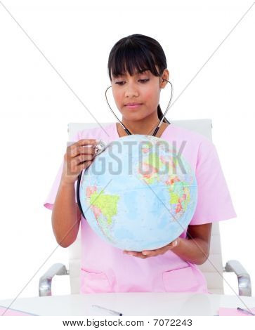 Portrait Of An Ethnic Doctor Examining A Terrestrial Globe