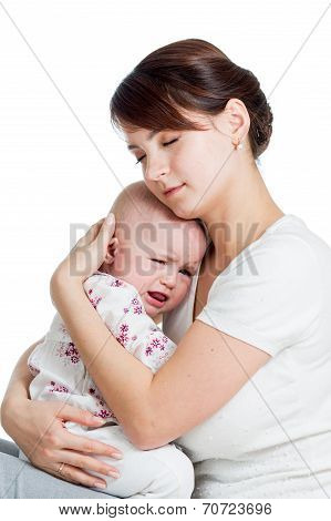 Mother Trying To Comfort Her Crying Baby Isolated