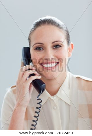 Portrait Of A Smiling Businesswoman Talking On Phone