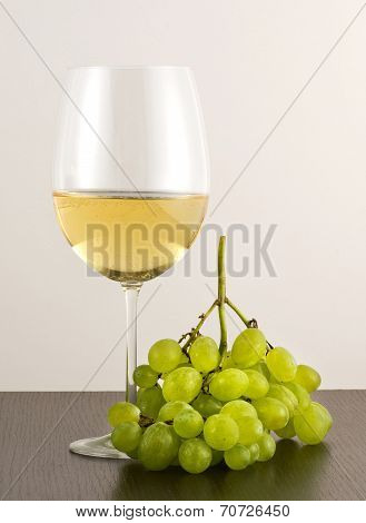 Glass Of White Wine With Green Grapes