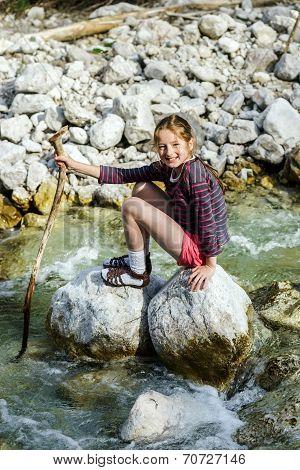 Teenage Girl Sitting On Stone