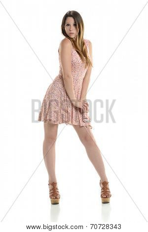 Young beautiful hispanic woman wearing a dress and heels isolated on a white background
