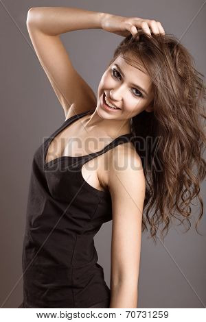Beautiful young girl in sports style with loose hair.