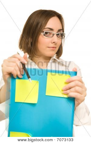 Picture Of A Young Secretary Holding A Folder