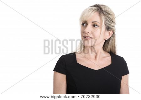 Portrait Of A Older Isolated Business Woman In Black Looking Sideways.