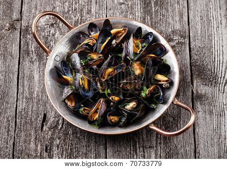 Boiled Mussels In Copper Cooking Dish On Dark Wooden Background