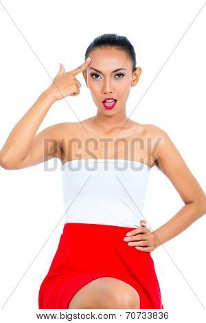 Young Asian woman showing emotions and showing the idiot sign