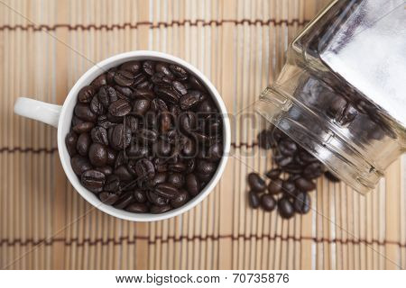 Roasted Coffee Beans In Glass And Bottle.