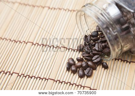 Coffee Beans Spilled From Bottle