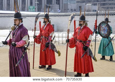 SEOUL - FEBRUARY 14: Royal guards at Gyeongbokgung Palace February 14, 2013 in Seoul, ROK. Guards have been in place at the palace, once the home of the king, since the 14th century.