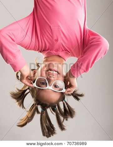 Little boy hanging upside down