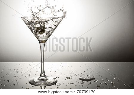 Olive Splashing On Martini