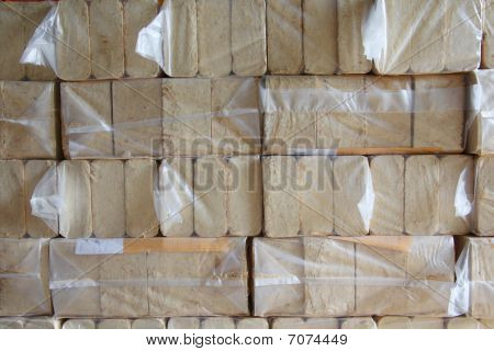Compressed Wood Chips In Plastic Packaging
