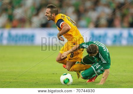 VIENNA, AUSTRIA - AUGUST 8 Marcel Sabitzer (#24 Rapid) and Usero (#8 Asteras) fight for the ball at a UEFA Europa League game on August 8, 2013 in Vienna, Austria.