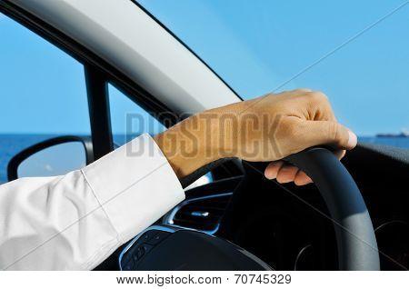 closeup of a man driving a car