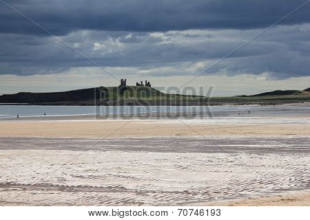 Dunstanburgh Castle With Stormy Skies