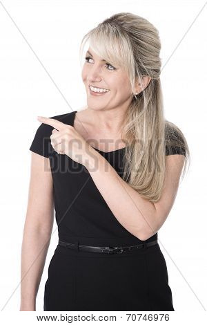 Isolated Happy Business Woman In Black Pointing At Text.