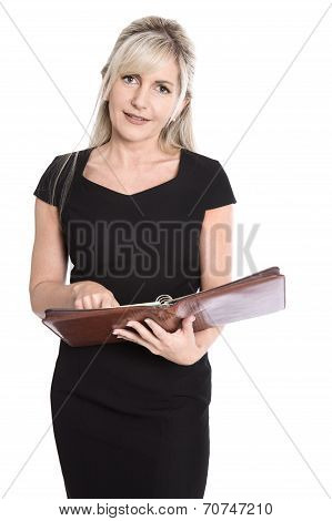 Isolated Businesswoman In Black Dress Planning Her Dates With Organizer.