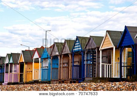 Colorful beach huts on the beach in EnGLAND