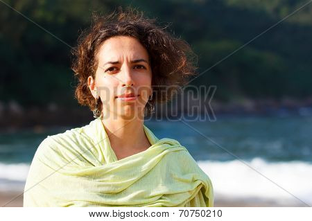 Young Beautiful Sad Woman With Curly Hair Outside