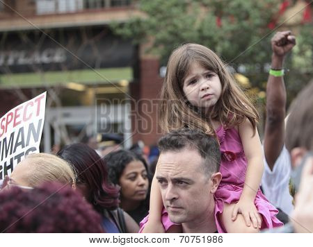 Little demonstrator on daddy's shoulders