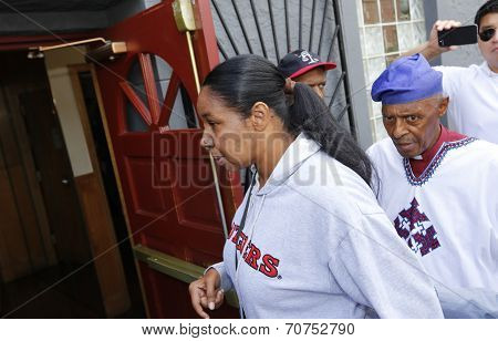 Esaw Garner entering church in Staten Island