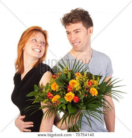 Man And Woman Standing Backwards With A Beautiful Bunch Of Flowers