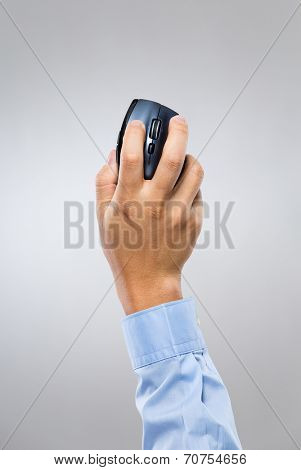 Businessman hand holding mouse