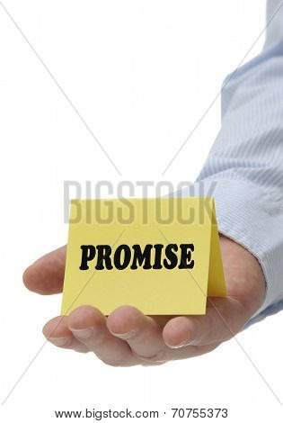 Business man holding yellow promise sign on hand