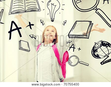 education and school concept - happy and smiling teenage girl with raised hands