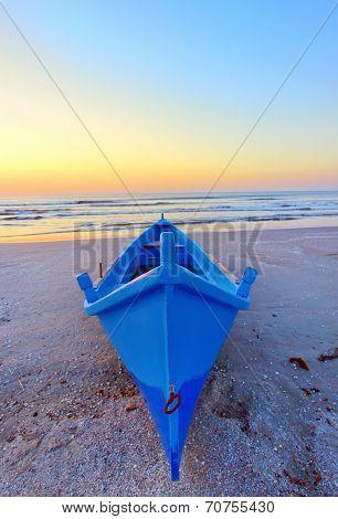 Fishing Boat On The Seashore At Sunrise
