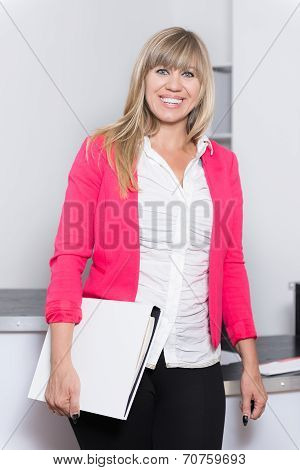 Smiling Woman Is Holding A File In The Office