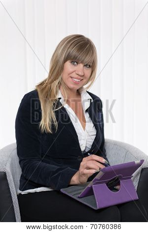Woman Is Working With A Tablet