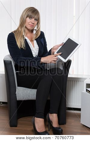Woman Is Pointing To A Tablet