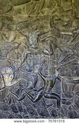 Ancient carvings on walls of Angkor Wat