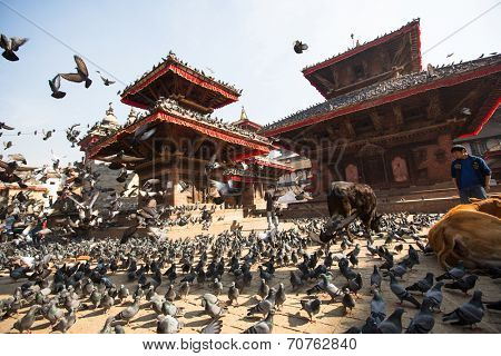 KATHMANDU, NEPAL - NOV 28, 2013: Old Durbar Square with pagodas. Largest city of Nepal, its cultural center, a population of over 1 mill people, density of 19867 people/Km.