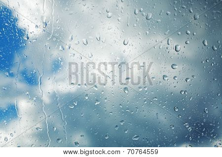 Rain Drops Running Down Clear Glass